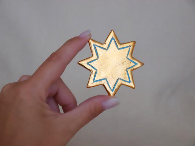 Sternchen (achtzackig, hellblau)